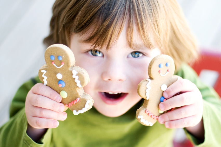 Child making gingerbread men