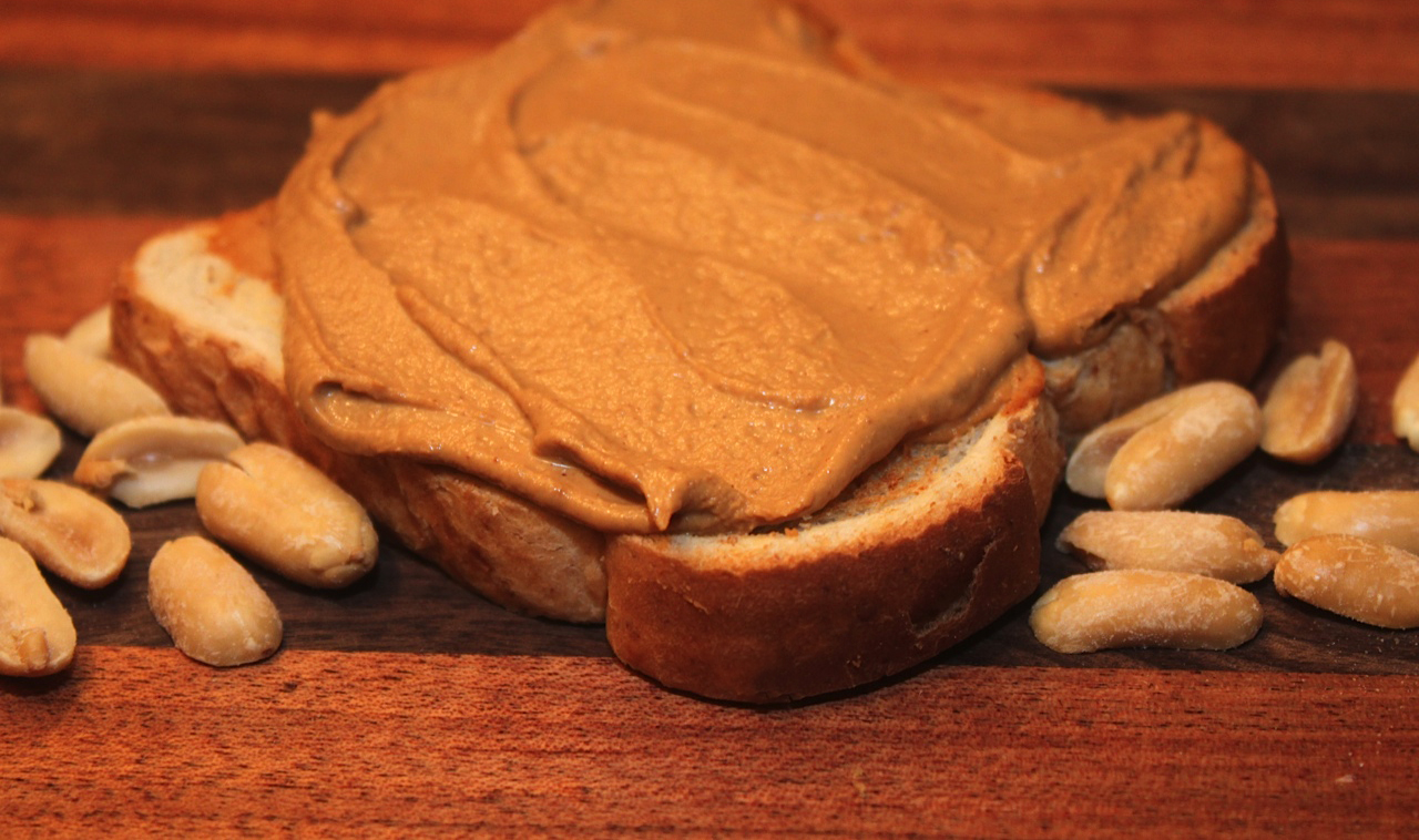 peanut butter on a slice of toast
