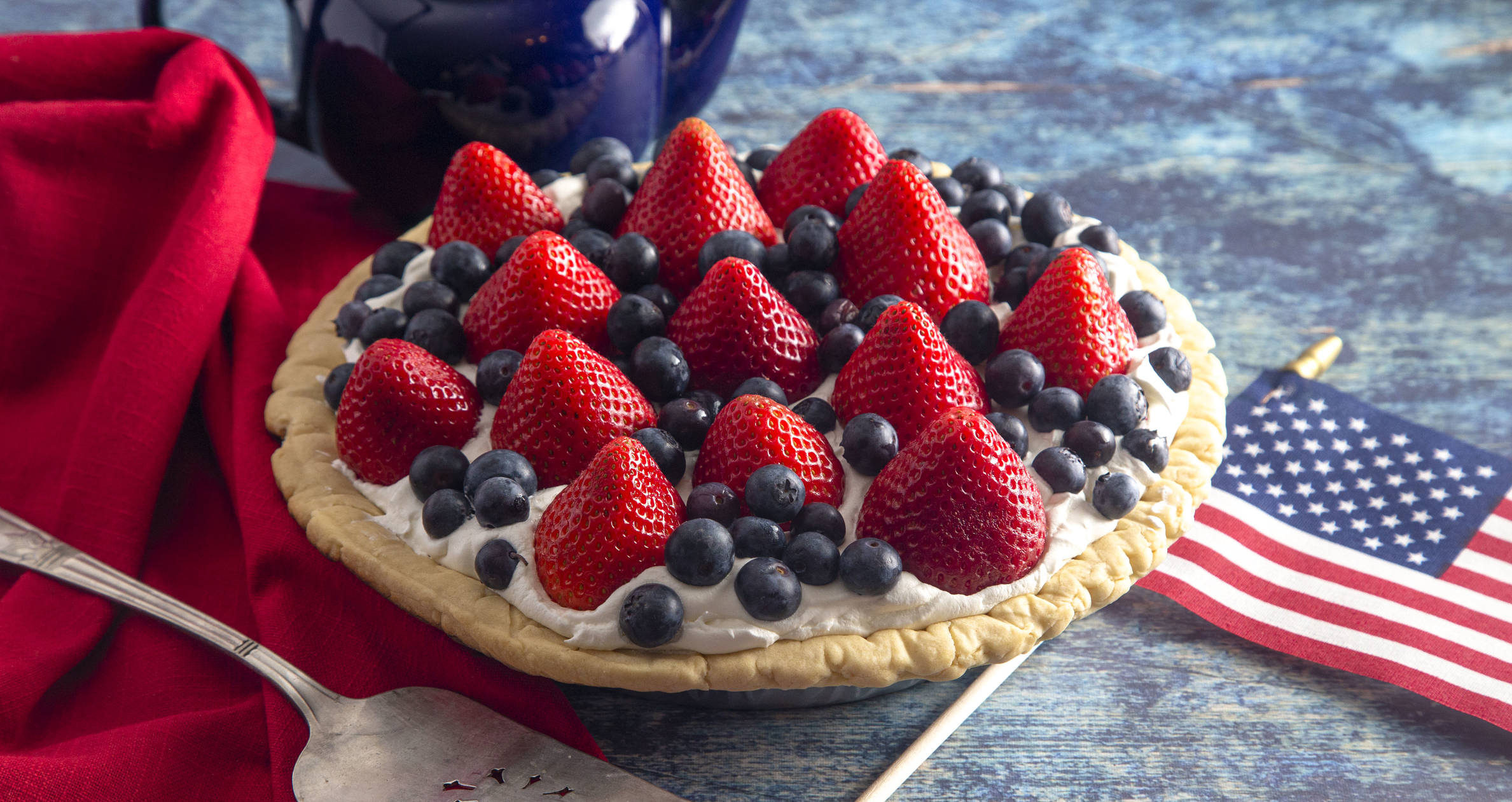 Strawberry and Blueberry Fresh Summer Pie on a Distressed Blue Wooden Table